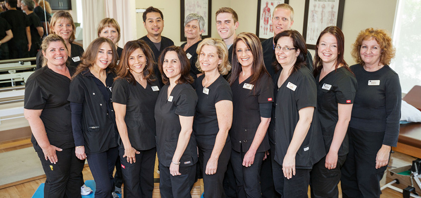 large staff photo in the rehabilitation room