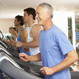 Various people running on a treadmill
