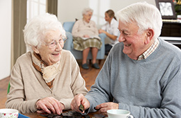 elderly couple looking fondly at each other