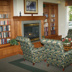 Park Place library with fireplace and comfortable chairs