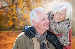 couple dressed warmly outside on a sunny Autumn day