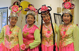 residents dressed in colorful costumes