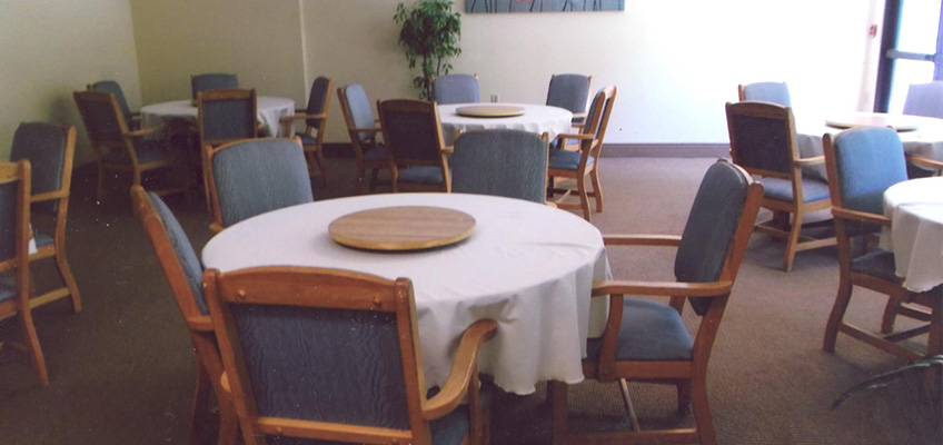 Dining room area set with table cloths and chairs