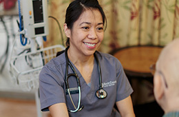 smiling woman with a stethoscope