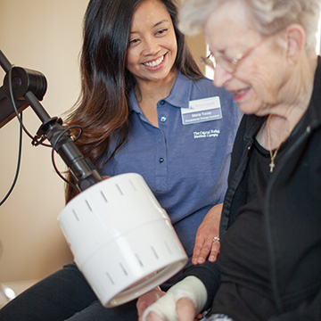 resident using therapy equipment