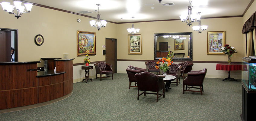interior lobby with desk chairs and fresh flowers