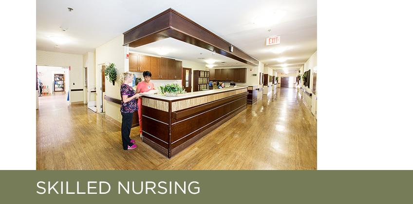 large nurses desk and hallways with a headling: skilled nursing