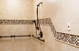 clean and neatly tiled shower area