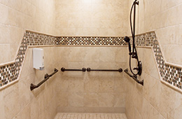 clean and neat shower area with nice tiling