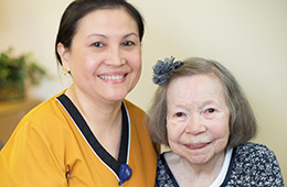smiling nurse and older woman