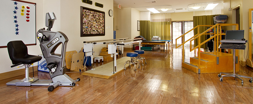 rehabilitation area with various pieces of exercise equiptment