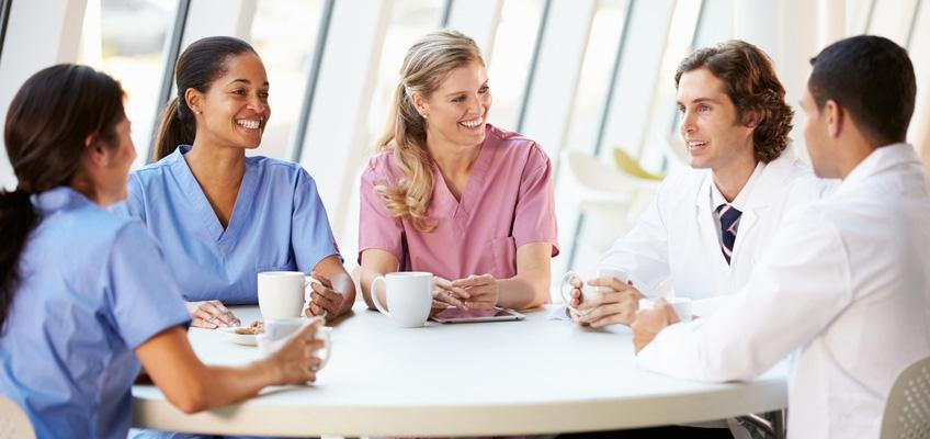 5 staff members having coffee