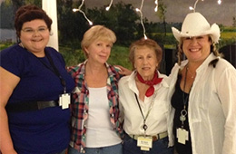 Caroline staff dressed up in western wear for an event